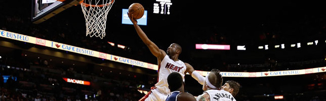 Heat streak now 19, top Hawks 98-81